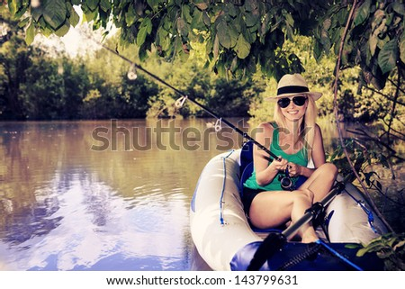 the outdoor portrait of a young fishing woman - stock photo