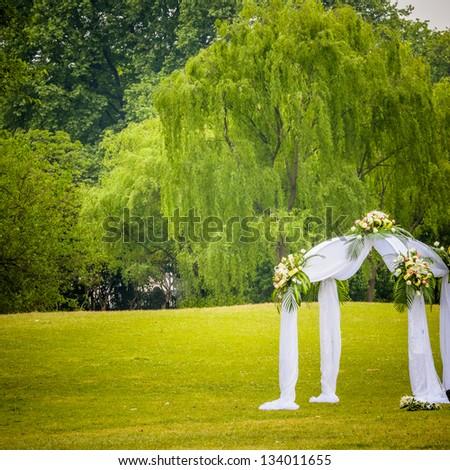 the outdoor wedding of a park. - stock photo