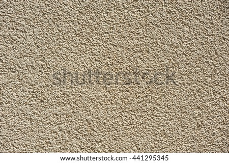 The outer surface of the wall of an apartment house plastered, rough texture/ Plastered Wall / fancy exterior plastering work of a wall, texture, background - stock photo