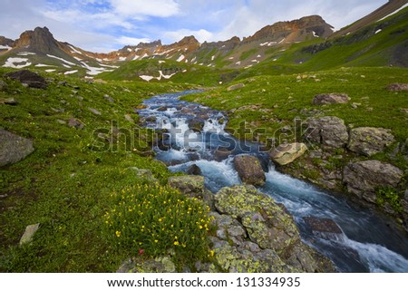 The Outlet. A cold alpine stream flows rapidly out of a high basin in the San Juan Mountains of Colorado.