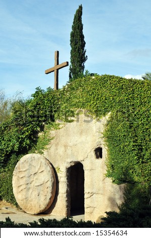The outside of a replica of the Garden Tomb where Jesus was buried, the stone rolled away from the entrance. - stock photo