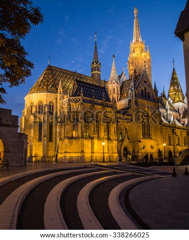 The outside of Matthias Church in Budapest Hungary at night shownig the gothic architecture. - stock photo