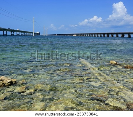 The Overseas Highway traverses the clear, shallow ocean in the Florida Keys. - stock photo