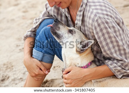 The owner with her dog on the beach. Best friends - stock photo