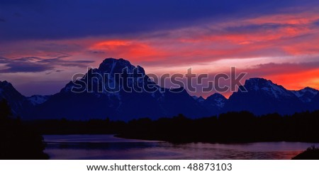 The Oxbow Bend of the Snake River and Mt. Moran, in Grand Teton National Park, Wyoming, photographed at sunset. - stock photo