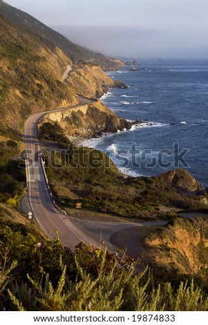 The Pacific Coast Highway winds along the Big Surf coastline in California. - stock photo