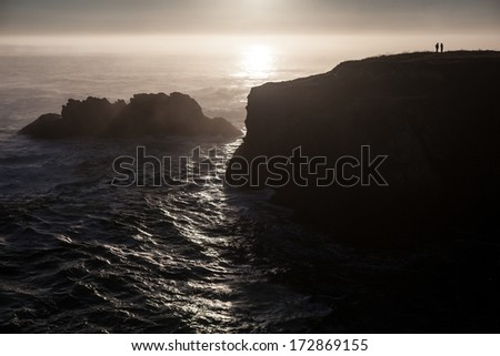 The Pacific Ocean batters the rugged northern California coastline in Mendocino. Highway 1 runs right along the coast and provides gorgeous and dramatic views of the ocean, the shore, and the land. - stock photo
