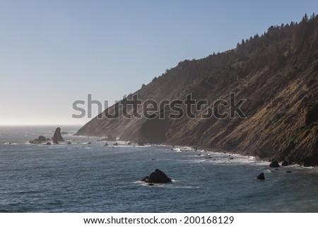 The Pacific Ocean has created dramatic scenery along Northern California's coastline. Eroded rocks, called sea stacks, form impressive vistas that can be viewed from the Pacific Coast highway. - stock photo