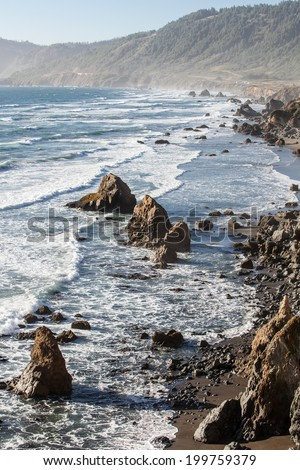 The Pacific Ocean has worn Northern California's coastline into dramatic, rugged scenery. Highway 1 is built along the coast, allowing drivers to view some of North America's most impressive vistas. - stock photo