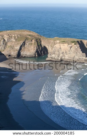The Pacific Ocean has worn Northern California's coastline into dramatic scenery. Eroded rocks and secluded coves form impressive vistas that can be viewed from the Pacific Coast highway. - stock photo