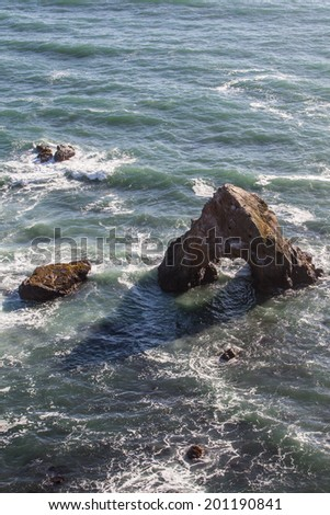 The Pacific Ocean has worn Northern California's coastline into dramatic scenery. The eroded shoreline forms impressive vistas that can be viewed from the Pacific Coast highway. - stock photo