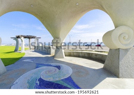 The Pacific Portal, aka Shelter Island Gazebo, at Point Loma, in San Diego, Southern California, United States of America. An Architectural arched art structure with mosaic tile ceiling and pathways. - stock photo