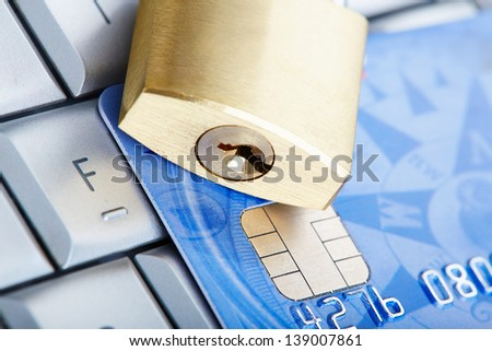 The padlock on a credit card lie on keyboard - stock photo