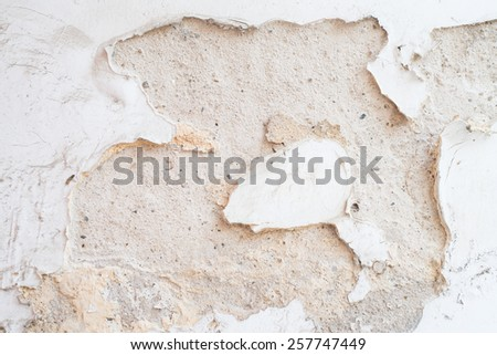 The paint is peeling off, falling apart, Damaged wall. - stock photo