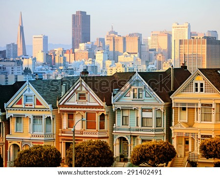 The Painted Ladies of San Francisco at sunset with downtown background - stock photo