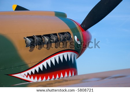 The painted nose of a P-40 Warhawk WWII fighter - stock photo