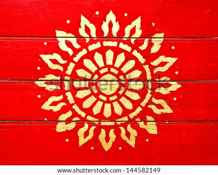 The Painting golden symbol of religion on wood in the  temple.The temple is open to the public and has beautiful murals on the walls. - stock photo