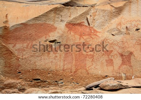 the painting on stone wall be prehistoric drawing age about 3,000 year, at patam of thailand - stock photo