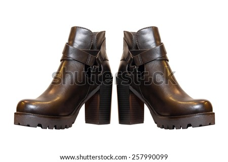 The pair of black leathers woman boots isolated on white background.     - stock photo