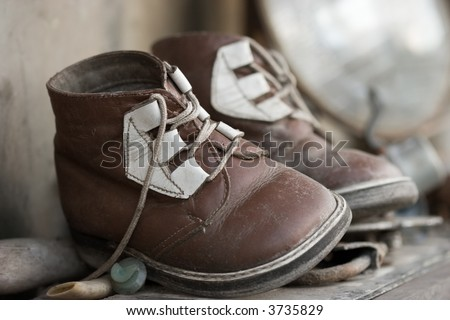 The pair of old baby shoes. Childhood or past time nostalgic concept. - stock photo