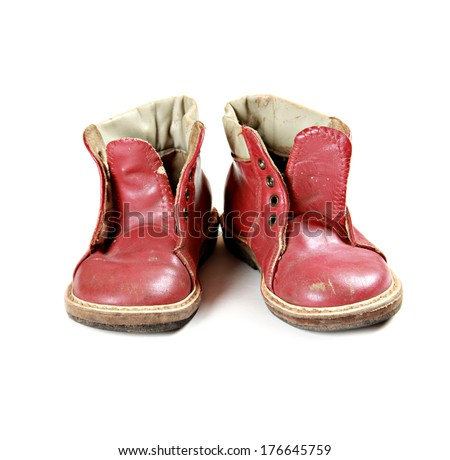The pair of old baby shoes isolated over white - stock photo