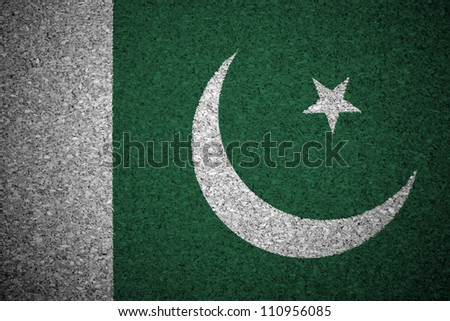 The Pakistani flag painted on a cork board. - stock photo