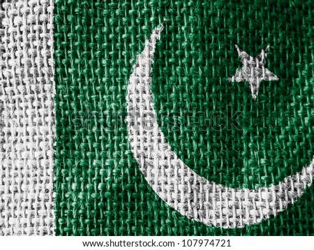The Pakistani flag painted on fabric surface - stock photo