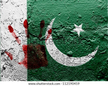 The Pakistani flag painted on grunge wall with bloody palmprint over it - stock photo