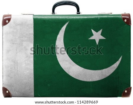 The Pakistani flag painted on  old grungy travel suitcase or trunk - stock photo