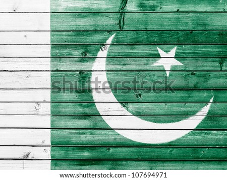 The Pakistani flag painted on wooden fence - stock photo
