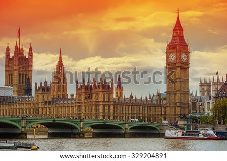 The Palace of Westminster at the Big Ben at Sunset. London, United Kingdom. Meeting Place of the House of Commons and the House of Lords. - stock photo