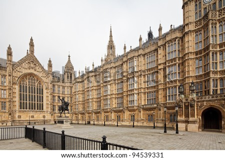 The Palace of Westminster (Houses of Parliament) facade with King Richard I statue in front, London, UK