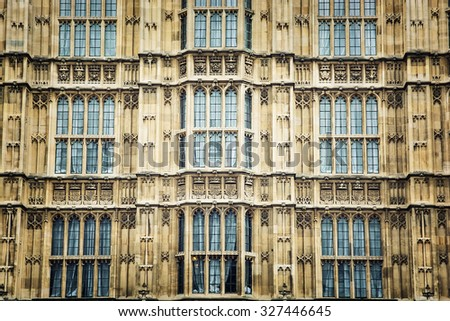 The Palace of Westminster is the meeting place of the House of Commons and the House of Lords, the two houses of the Parliament of the United Kingdom. Architectural theme. - stock photo