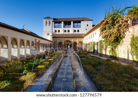 The Palacio de Generalife was the summer palace and country estate of the Nasrid Emirs (Kings) of the Emirate of Granada in Al-Andalus. - stock photo