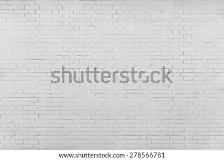 the pale gray textured surface of a brick wall for empty and pure backgrounds - stock photo
