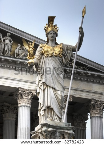 The Pallas Athene Fountain was build in front of the main portal of Vienna's Parliament Buildings in 1902. The 4m figure of Pallas Athene armed with a lance is the work of Kundmann. - stock photo