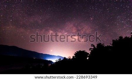 the Panorama Milky Way rises over the mountain in Thailand.Long exposure photograph. - stock photo