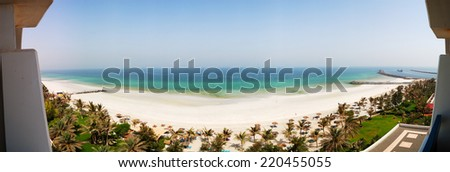 The panorama of beach and turquoise water of the luxury hotel, Ajman, UAE - stock photo