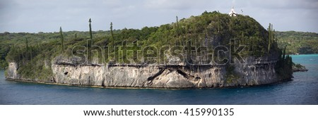 The panoramic view of coral made island Lifou with a church on a top of a hill (Easo, New Caledonia). - stock photo