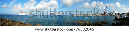 The panoramic view of cruise liners anchored near George Town on Grand Cayman Island, one of the most popular touristic ports in Caribbean. - stock photo