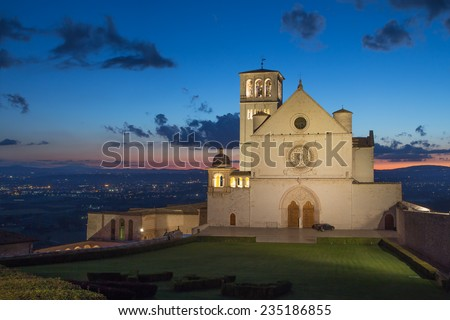The Papal Basilica of St. Francis of Assisi at sunset (Assisi, Umbria, Italy) - stock photo
