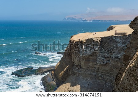 the Paracus National Reserve view point , Peru - Desert mountain with coastline and sea wave - stock photo