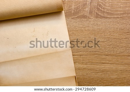 The parchment is rolled into a scroll. - stock photo