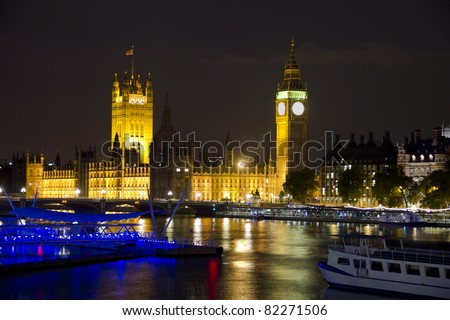 The Parliament, Big Ben and the River Thames by night in London, England - stock photo