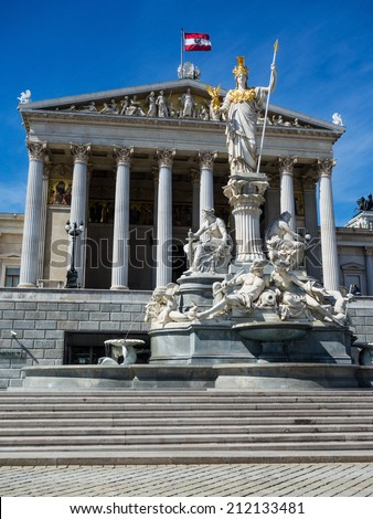 "the parliament in vienna, austria. with the statue of ""pallas athene"" the greek goddess of wisdom."