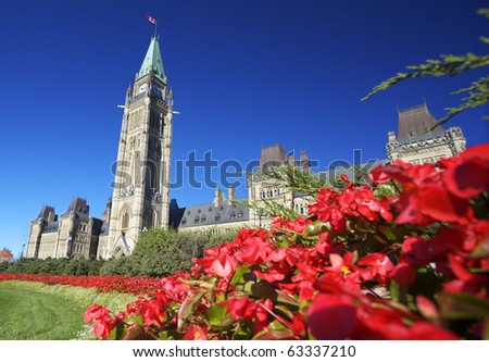 The Parliament of Canada with red flowers in the foreground - stock photo