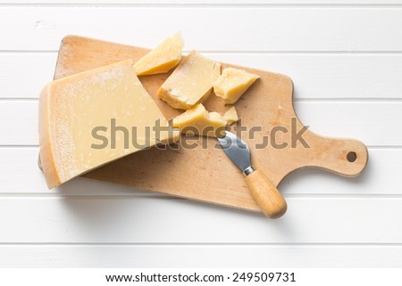 the parmesan cheese on cutting board - stock photo
