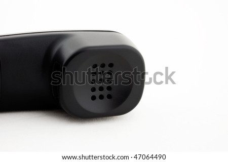 the part of black phone earpiece  on white background.
