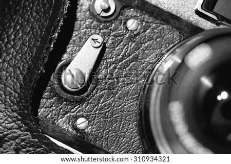 The part of old camera. Black and white image - stock photo