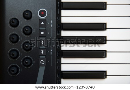 The Part of Professional MIDI-keyboard with controls - stock photo